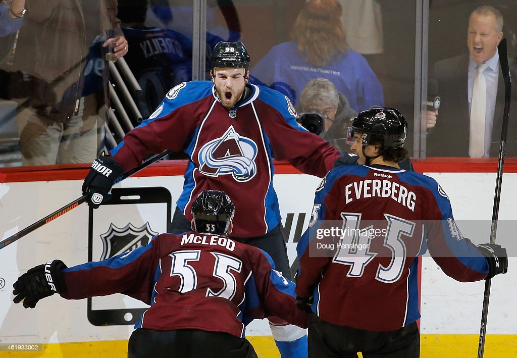 <a gi-track='captionPersonalityLinkClicked' href=/galleries/search?phrase=Ryan+O%27Reilly&family=editorial&specificpeople=4754037 ng-click='$event.stopPropagation()'>Ryan O'Reilly</a> #90 of the Colorado Avalanche celebrates his game tying goal against the Boston Bruins with teammates <a gi-track='captionPersonalityLinkClicked' href=/galleries/search?phrase=Cody+McLeod&family=editorial&specificpeople=2242985 ng-click='$event.stopPropagation()'>Cody McLeod</a> #55 and <a gi-track='captionPersonalityLinkClicked' href=/galleries/search?phrase=Dennis+Everberg&family=editorial&specificpeople=13469265 ng-click='$event.stopPropagation()'>Dennis Everberg</a> #45 of the Colorado Avalanche late in the third period at Pepsi Center on January 21, 2015 in Denver, Colorado. The Avalanche defeated the Bruins 3-2 in an overtime shootout.