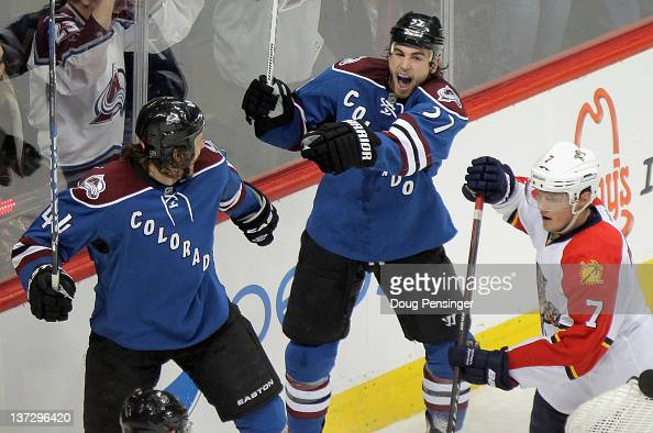Ryan O'Reilly of the Colorado Avalanche celebrates his game winning goal in overtime with teammate Ryan Wilson of the Colorado Avalanche as Dmitry...