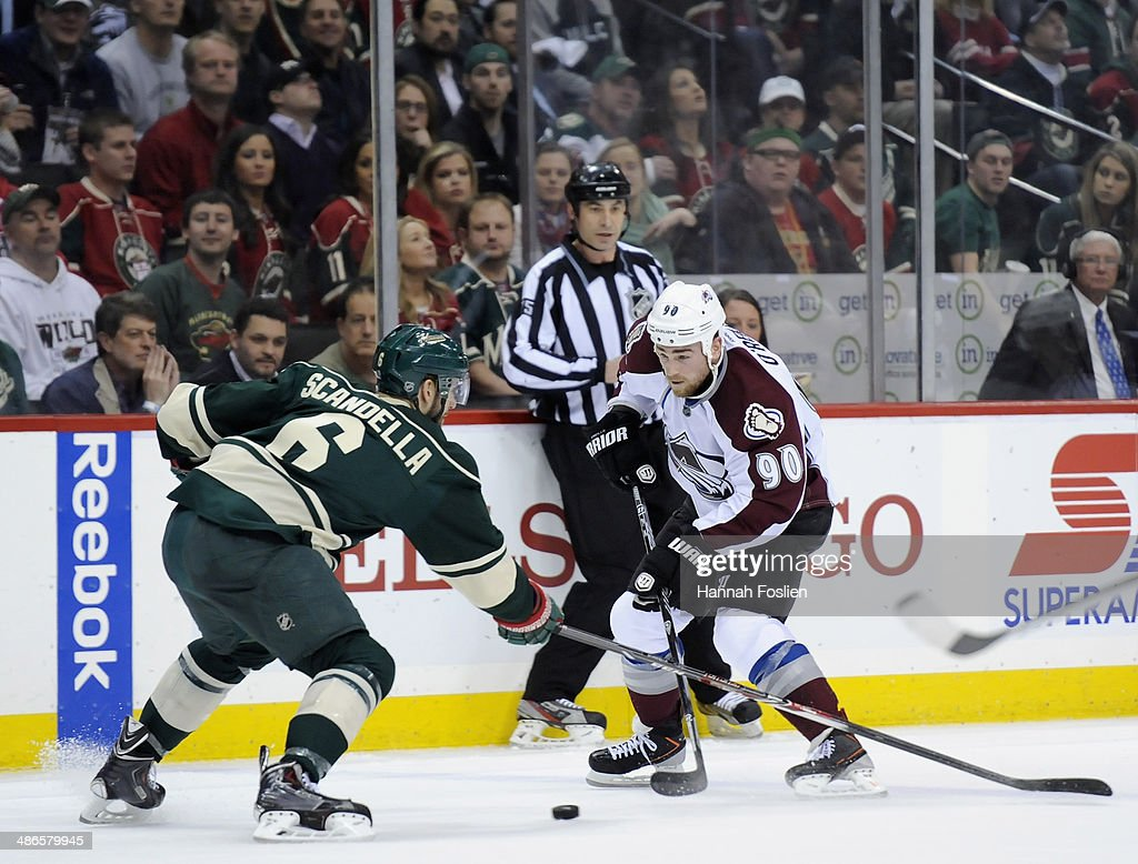 <a gi-track='captionPersonalityLinkClicked' href=/galleries/search?phrase=Ryan+O%27Reilly&family=editorial&specificpeople=4754037 ng-click='$event.stopPropagation()'>Ryan O'Reilly</a> #90 of the Colorado Avalanche controls the puck against <a gi-track='captionPersonalityLinkClicked' href=/galleries/search?phrase=Marco+Scandella&family=editorial&specificpeople=5408903 ng-click='$event.stopPropagation()'>Marco Scandella</a> #6 of the Minnesota Wild during the first period in Game Four of the First Round of the 2014 NHL Stanley Cup Playoffs on April 24, 2014 at Xcel Energy Center in St Paul, Minnesota. The Wild defeated the Avalanche 2-1.
