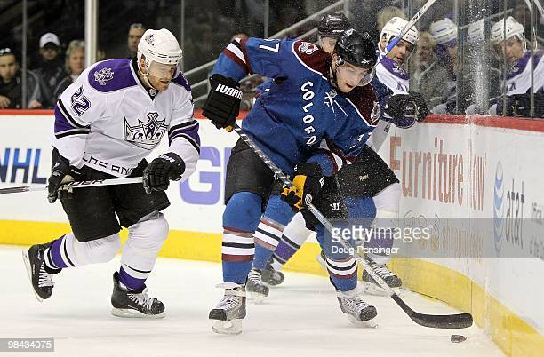 Ryan O'Reilly of the Colorado Avalanche controls the puck while under pressure from Jeff Halpern of the Los Angeles Kings during NHL action at the...