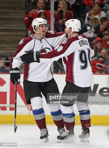 Ryan O'Reilly of the Colorado Avalanche get a hug from Nick Holden after scoring a power play goal in the first period against the Chicago Blackhawks...