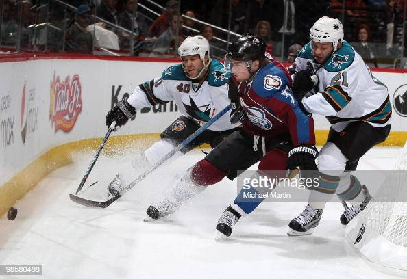 Ryan O'Reilly of the Colorado Avalanche skates against Scott Nichol and Kent Huskins of the San Jose Sharks in Game Four of the Western Conference...