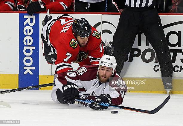 Ryan O'Reilly of the Colorado Avalanche tries to pass after hitting the ice under pressure from Brent seabrook of the Chicago Blackhawks at the...