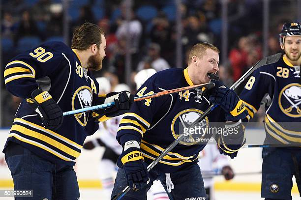 Ryan O'Reilly of the puts a puck in the mouth of teammate Nicolas Deslauriers of the Buffalo Sabres during warmups before the game against the...