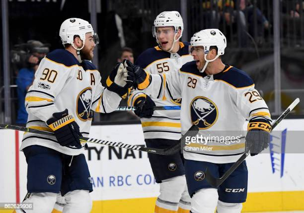 Ryan O'Reilly Rasmus Ristolainen and Jason Pominville of the Buffalo Sabres celebrate after teammate Evander Kane scored against the Vegas Golden...