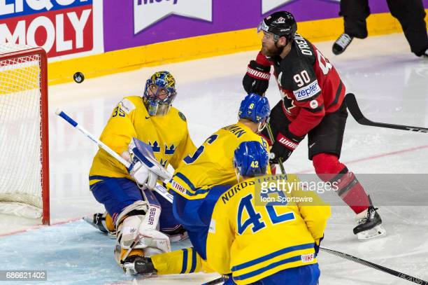 Ryan OReilly scores a goal against Goalie Henrik Lundqvist during the Ice Hockey World Championship Gold medal game between Canada and Sweden at...