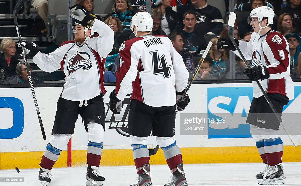 Ryan O'Reilly #90, Tyson Barrie #4 and Matt Duchene #9 of the Colorado Avalanche celebrate after a goal against the San Jose Sharks during an NHL game on December 23, 2013 at SAP Center in San Jose, California.