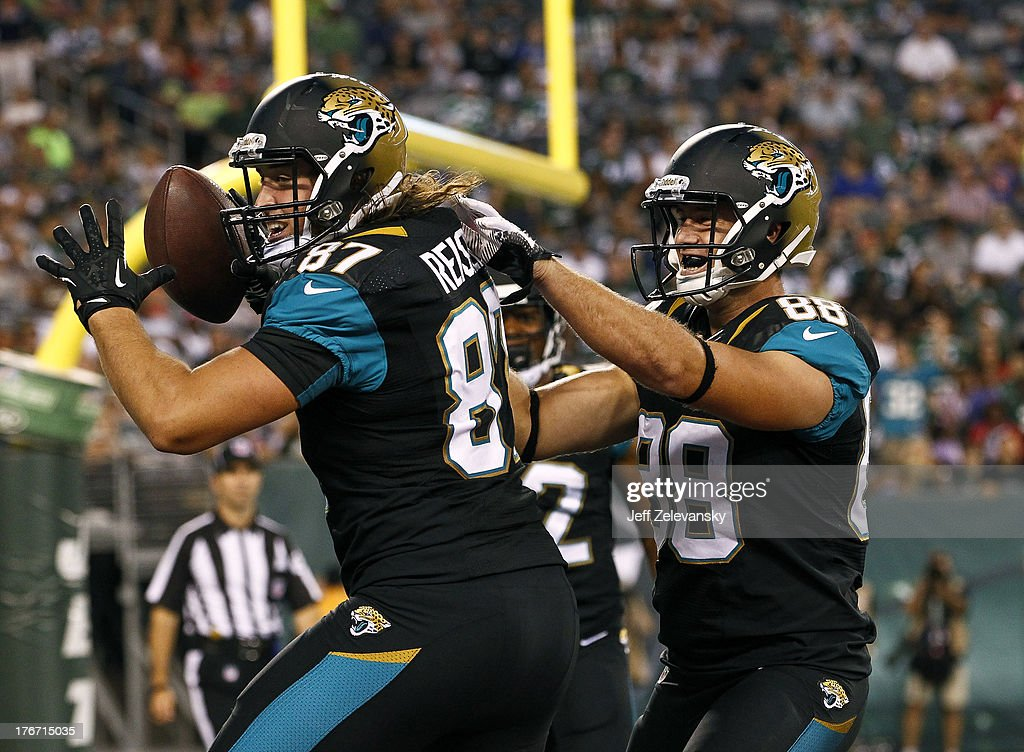 Ryan Otten #88 and Allen Reisner #87 of the Jacksonville Jaguars celebrate a touchdown against the New York Jets during their preseason game at MetLife Stadium on August 17, 2013 in East Rutherford, New Jersey.