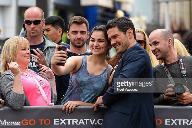 Ryan Paevey visits 'Extra' at Universal Studios Hollywood on May 12 2015 in Universal City California