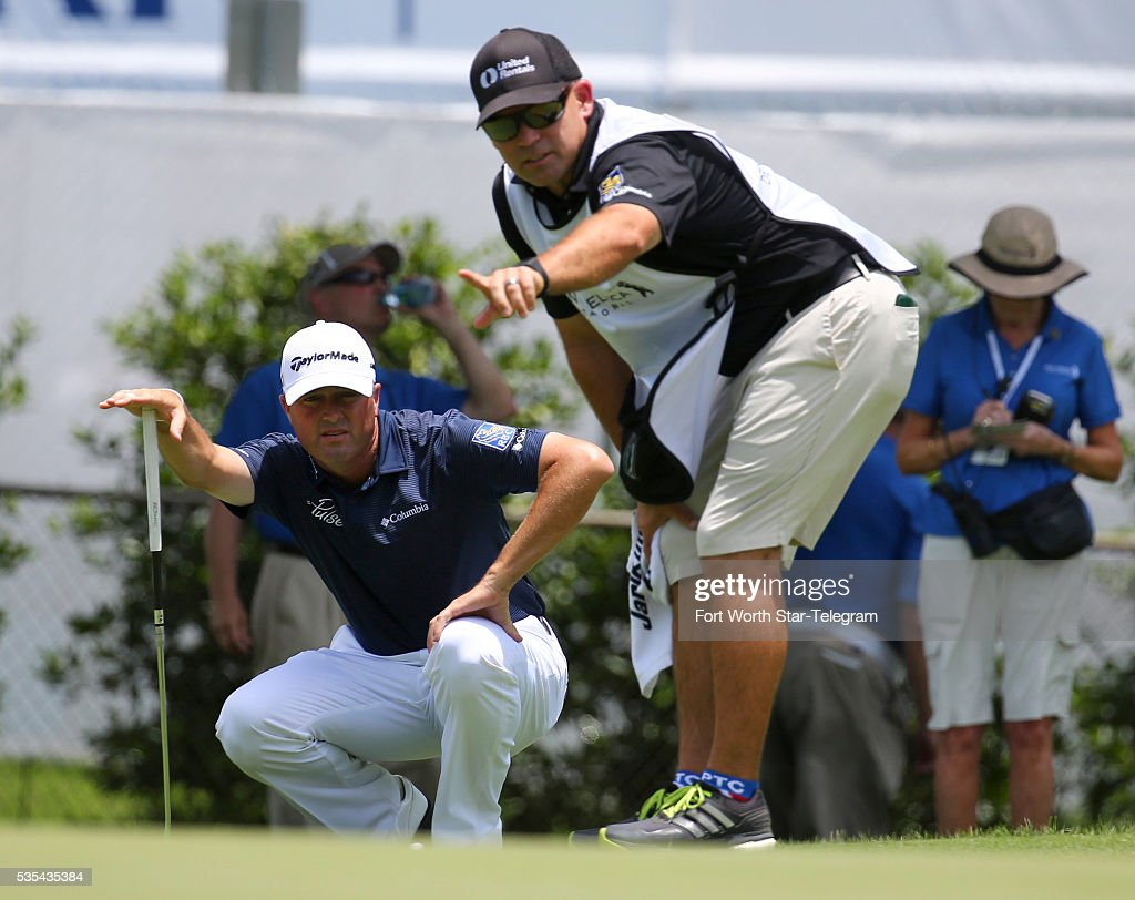 Ryan Palmer gets help lining up a putt from caddie James Edmonson on the fourth green during the Dean & Deluca Invitational on Sunday May 29, 2016, at the Colonial Country Club in Fort Worth, Texas.