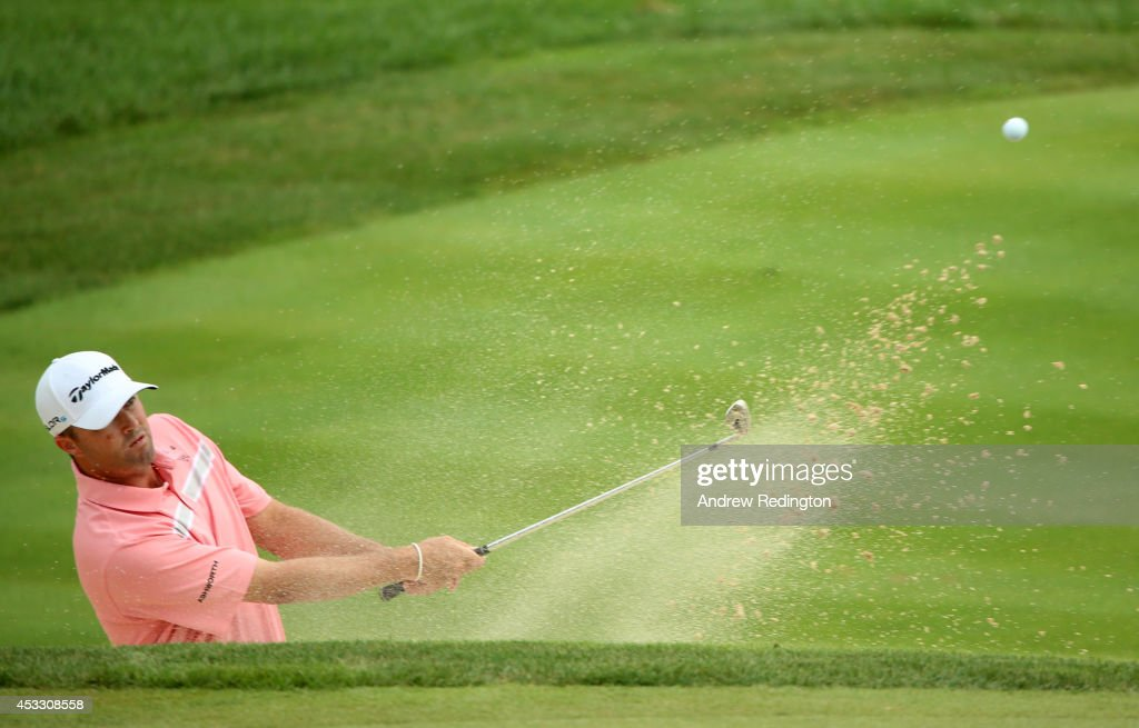 Ryan Palmer of the United States hits a shot from a bunker on the seventh hole during the first round of the 96th PGA Championship at Valhalla Golf Club on August 7, 2014 in Louisville, Kentucky.