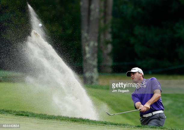 Ryan Palmer takes his shot out of the bunker on the seventh hole during the third round of the Deutsche Bank Championship at the TPC Boston on August...