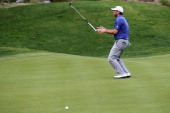Ryan Palmer tosses his club after missing a putt on the 16th green during the final round of the Humana Challenge in partnership with the Clinton...