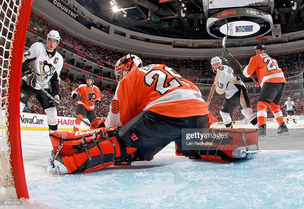 Ryan Parent Chris Pronger and goaltender Ray Emery of the Philadelphia Flyers watch the puck slide wide of the net as Sidney Crosby and Bill Guerin...