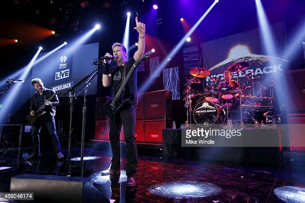 Ryan Peak Chad Kroeger and Daniel Adair from the band Nickelback performs at iHeartRadio Theater on November 18 2014 in Burbank California