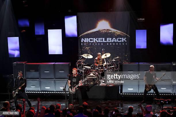 Ryan Peak Chad Kroeger Daniel Adair and Mike Kroeger from the band Nickelback performs at iHeartRadio Theater on November 18 2014 in Burbank...