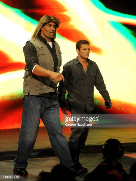 Ryan Phillippe walks with the Great Kahali to the ring at the WWE Monday night Raw at the Izod Center on April 19 2010 in East Rutherford New Jersey