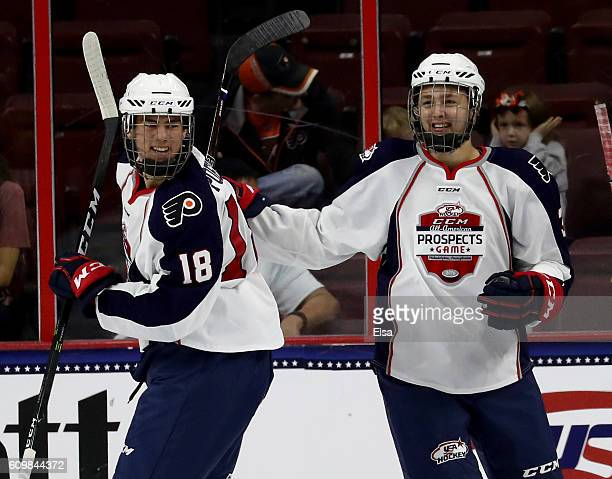 Ryan Poehling and Nate Knoepke of Team LeClair celebrate a goal against Team Howe during the CCM/USA Hockey AllAmerican Prospects Game on September...