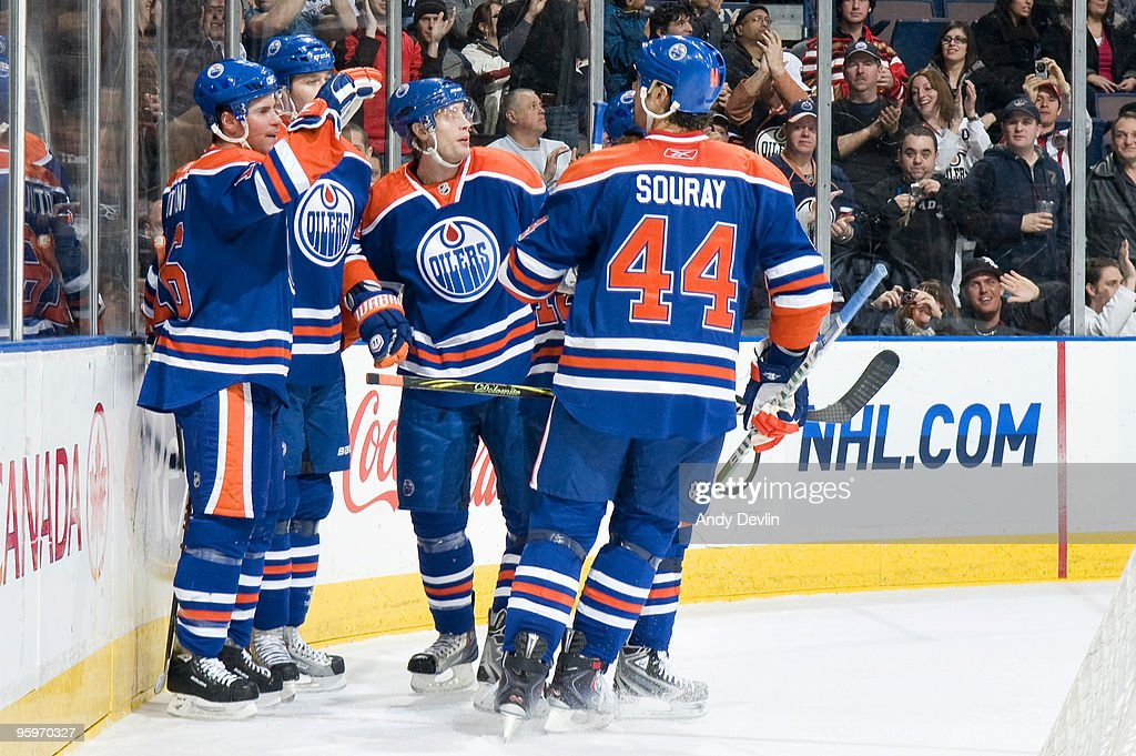 Ryan Potulny of the Edmonton Oilers celebrates a first period goal with his teammates against the Dallas Stars on January 22 2010 at Rexall Place in...