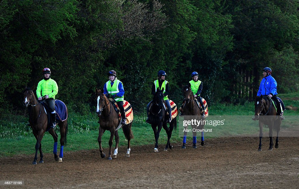 Ryan Powell riding Lucky Kristale (2R) on Long Hill Gallop with trainer George Margarson riding his hack prior to running in the 1000 Guineas in Newmarket on April 10, 2014 in Lingfield, England.