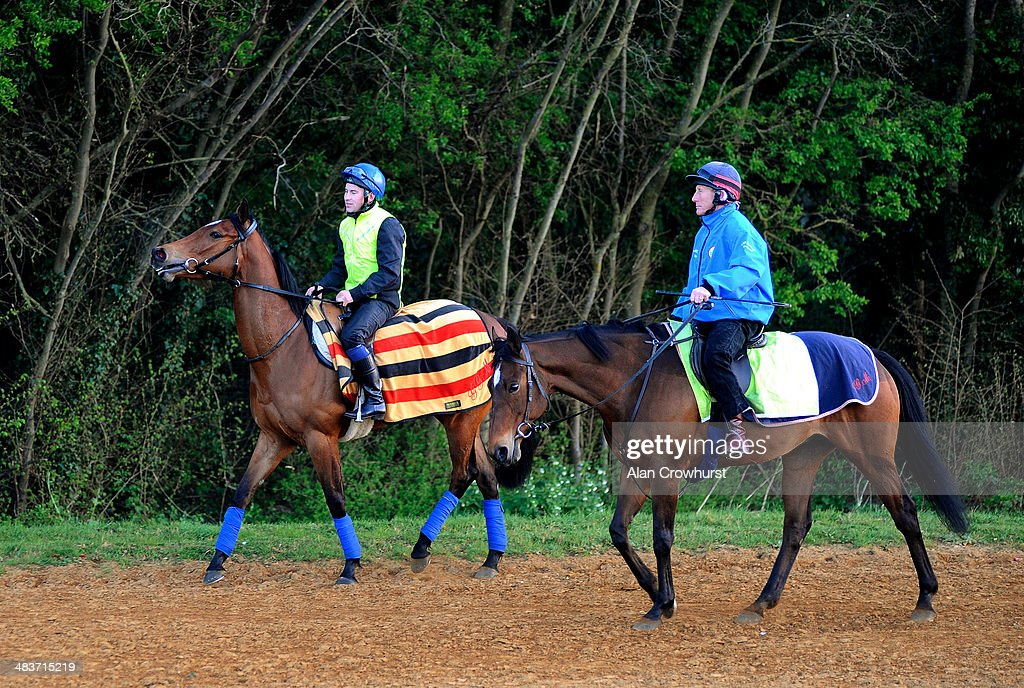 Ryan Powell riding Lucky Kristale (L) on Long Hill Gallop with trainer George Margarson riding his hack prior to running in the 1000 Guineas in Newmarket on April 10, 2014 in Lingfield, England.