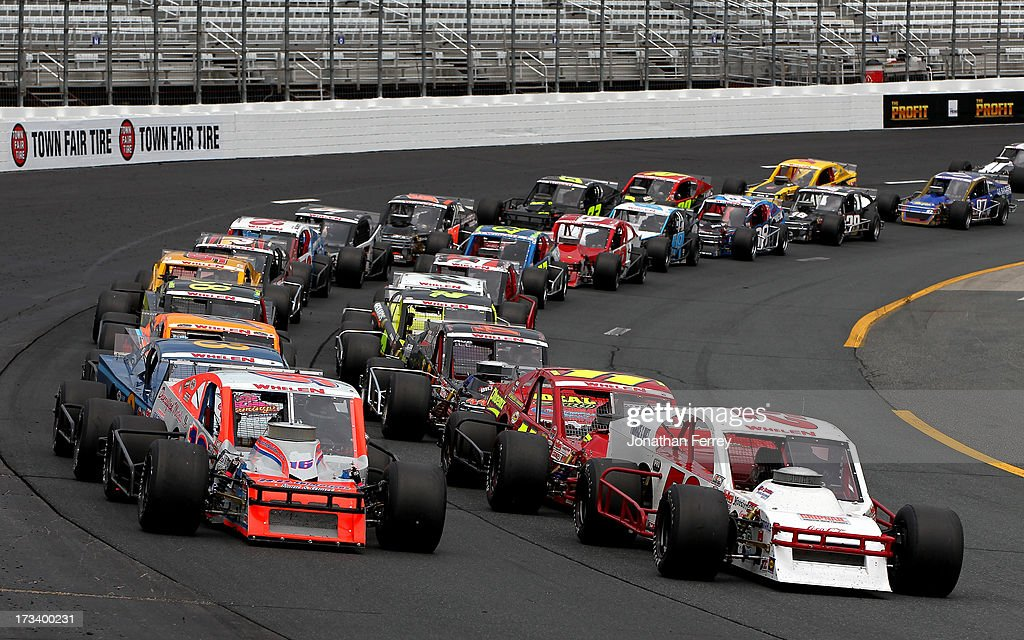 Ryan Preece, driver of the #16 East West Marine/Diversified Metals Ford, and Doug Coby, driver of the #52 Furnace & Duct/Seekonk Grand Prix Chevrolet, lead the field during the NASCAR Whelen Modified Tour Town Fair Tire 100 at New Hampshire Motor Speedway on July 13, 2013 in Loudon, New Hampshire.