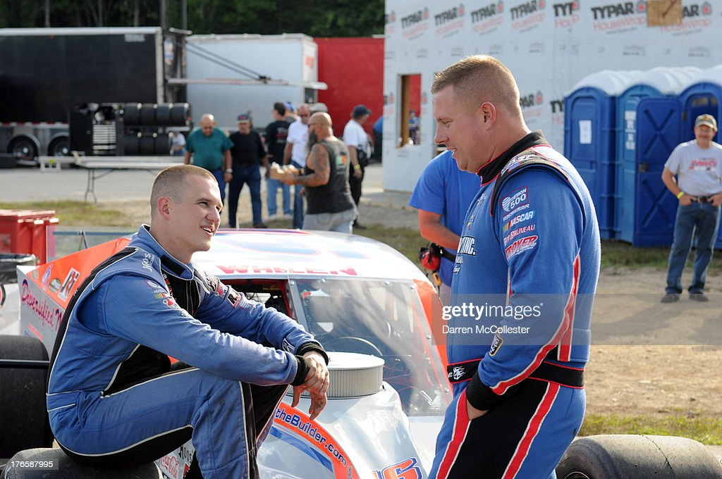Ryan Preece (L) driver of the #16 East West Marine/Diversified Metals Ford talks with Jimmy Blewett driver of the #76 John Blewett Inc.,/Sims Metal Chevrolet prior to qualifying at the Budweiser King of Beers 150 at Thompson Speedway August 15, 2013 in Thompson, Connecticut.
