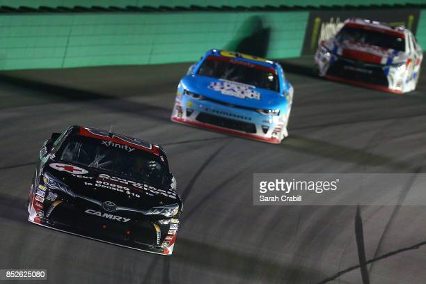Ryan Preece driver of the Hurricane Relief Toyota leads Daniel Hemric driver of the Blue Gate Bank Chevrolet and Matt Tifft driver of the...