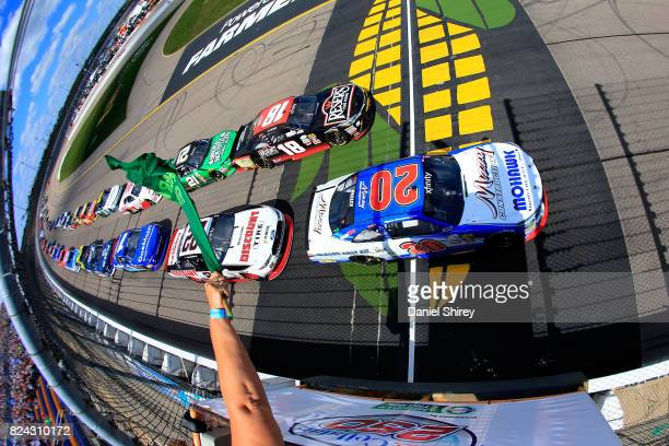 Ryan Preece driver of the MoHawk Northeast Inc Toyota leads the field past the green flag to start the NASCAR XFINITY Series US Cellular 250...