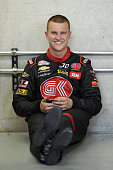 Ryan Preece driver of the teamjdmotorsportscom Chevrolet sits in the garage area during practice for the NASCAR XFINITY Series Lilly Diabetes 250 at...