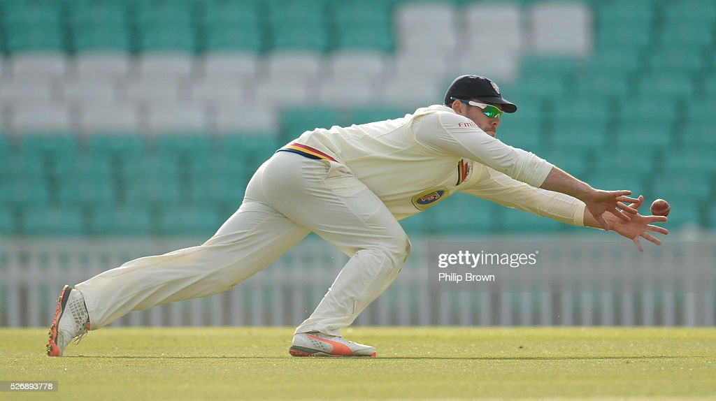 Ryan Pringle of Durham attempts to stop a ball during day one of the Specsavers County Championship Division One match between Surrey and Durham at the Kia Oval on May 1, 2016 in London, England.
