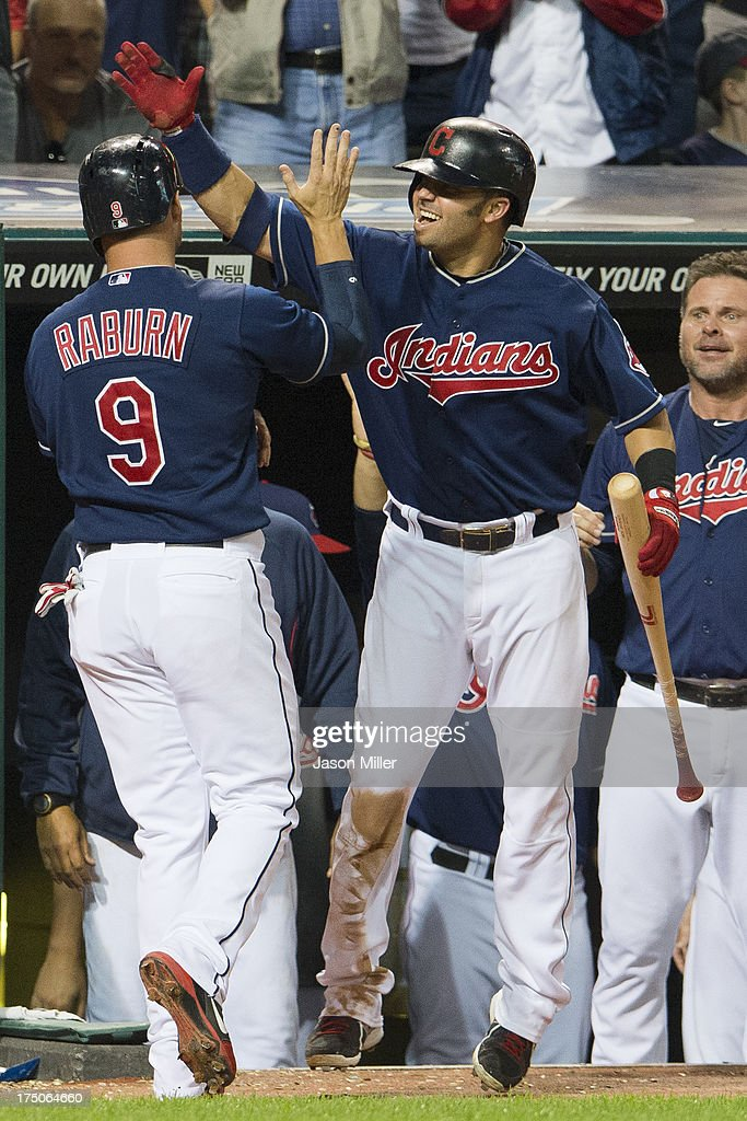 <a gi-track='captionPersonalityLinkClicked' href=/galleries/search?phrase=Ryan+Raburn&family=editorial&specificpeople=2541483 ng-click='$event.stopPropagation()'>Ryan Raburn</a> #9 celebrates with <a gi-track='captionPersonalityLinkClicked' href=/galleries/search?phrase=Nick+Swisher&family=editorial&specificpeople=206417 ng-click='$event.stopPropagation()'>Nick Swisher</a> #33 of the Cleveland Indians after Raburn scored during the eighth inning against the Chicago White Sox at Progressive Field on July 30, 2013 in Cleveland, Ohio.