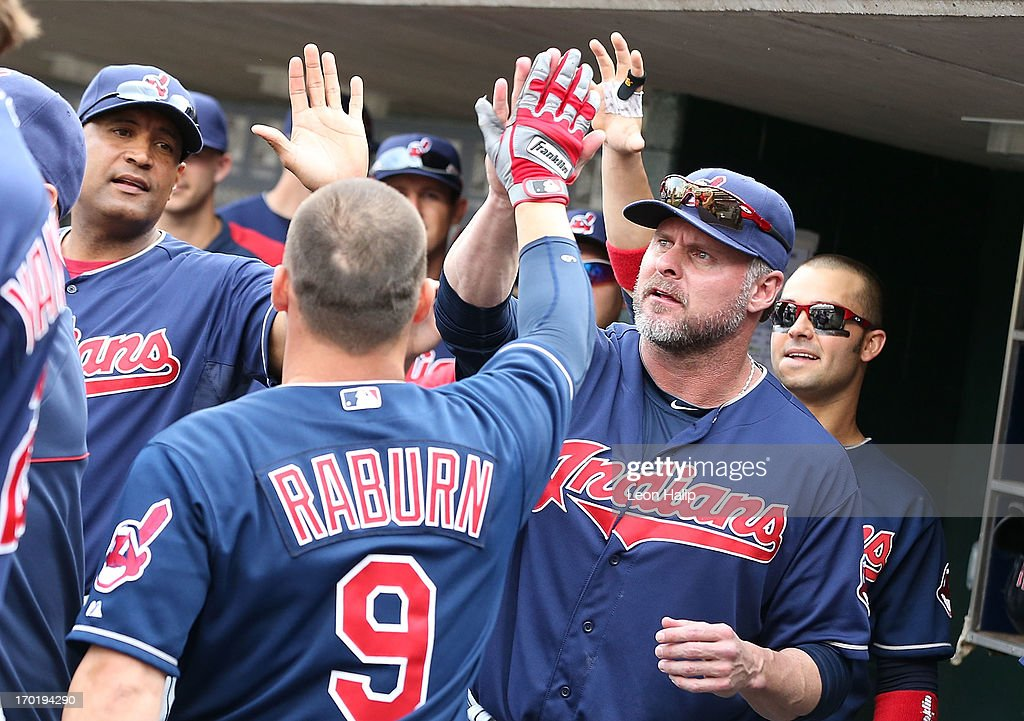 <a gi-track='captionPersonalityLinkClicked' href=/galleries/search?phrase=Ryan+Raburn&family=editorial&specificpeople=2541483 ng-click='$event.stopPropagation()'>Ryan Raburn</a> #9 of the Cleveland Indians celebrates with his teammates after hitting a two-run home run to left field in the seventh inning of the game against the Detroit Tigers at Comerica Park on June 8, 2013 in Detroit, Michigan. The Tigers defeated the Indians 6-4.