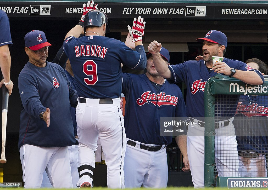 <a gi-track='captionPersonalityLinkClicked' href=/galleries/search?phrase=Ryan+Raburn&family=editorial&specificpeople=2541483 ng-click='$event.stopPropagation()'>Ryan Raburn</a> #9 of the Cleveland Indians celebrates with manager <a gi-track='captionPersonalityLinkClicked' href=/galleries/search?phrase=Terry+Francona&family=editorial&specificpeople=171936 ng-click='$event.stopPropagation()'>Terry Francona</a> #17 after Rayburn hit a solo home run during the fourth inning against the Washington Nationals at Progressive Field on June 14, 2013 in Cleveland, Ohio.