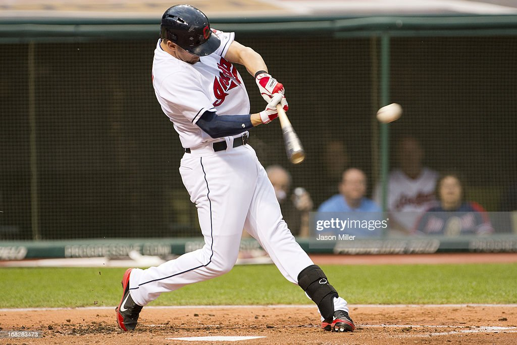 <a gi-track='captionPersonalityLinkClicked' href=/galleries/search?phrase=Ryan+Raburn&family=editorial&specificpeople=2541483 ng-click='$event.stopPropagation()'>Ryan Raburn</a> #9 of the Cleveland Indians hits a double during the third inning against the Oakland Athletics at Progressive Field on May 7, 2013 in Cleveland, Ohio.