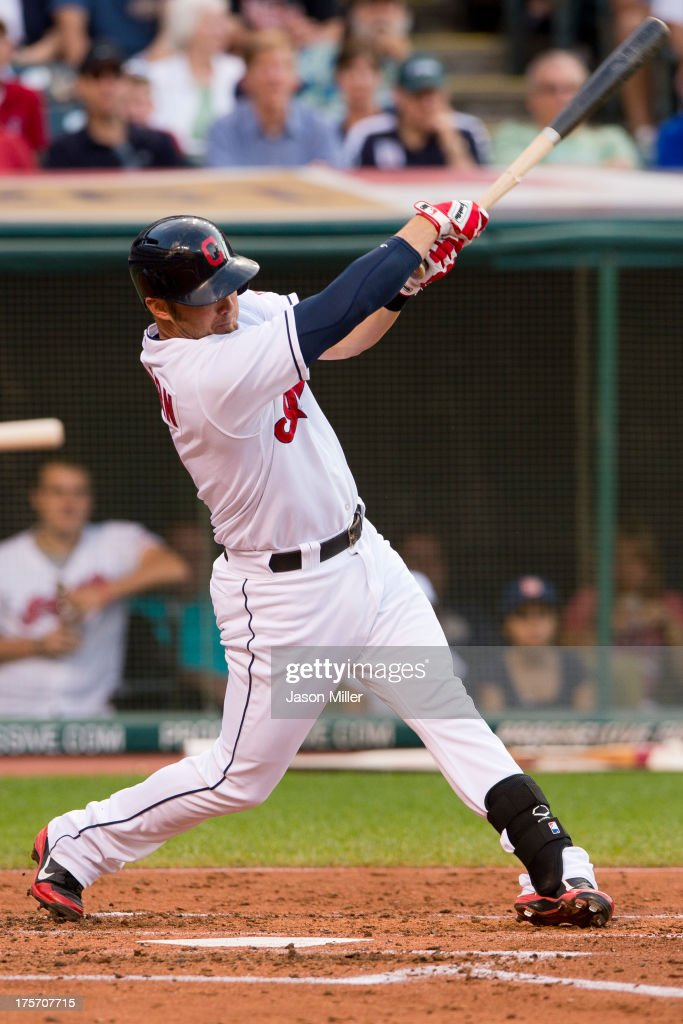 <a gi-track='captionPersonalityLinkClicked' href=/galleries/search?phrase=Ryan+Raburn&family=editorial&specificpeople=2541483 ng-click='$event.stopPropagation()'>Ryan Raburn</a> #9 of the Cleveland Indians hits an RBI ground out to second during the second inning against the Cleveland Indians at Progressive Field on August 6, 2013 in Cleveland, Ohio.