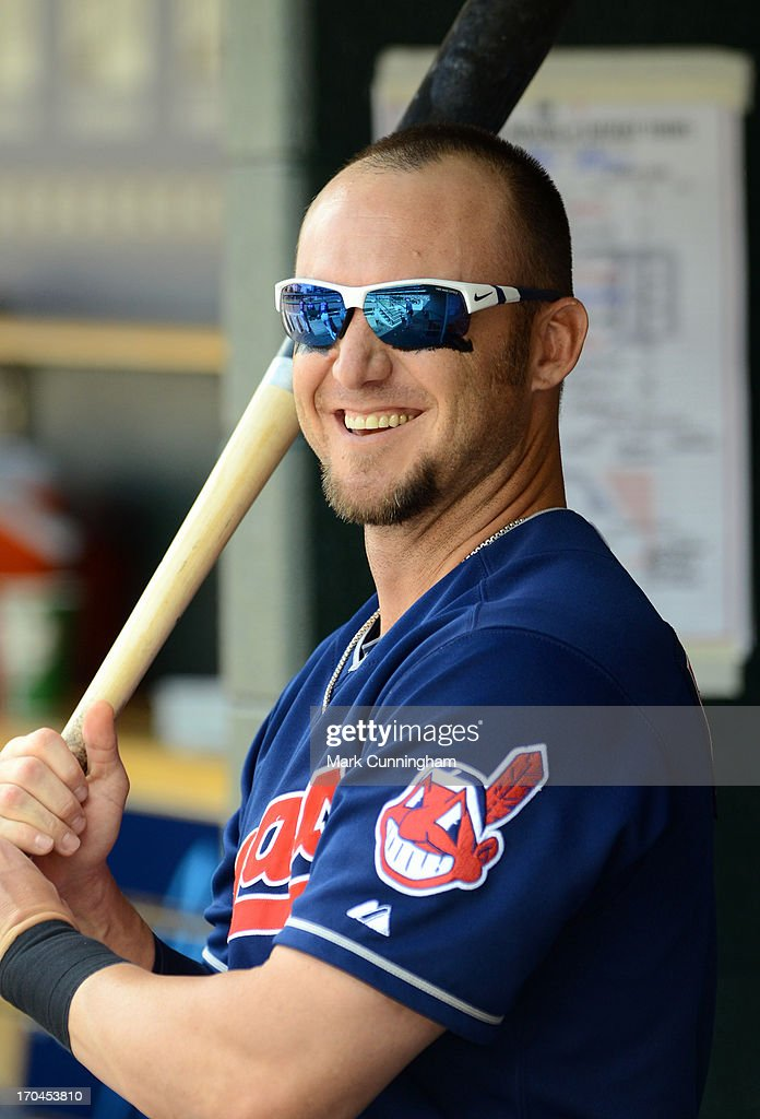<a gi-track='captionPersonalityLinkClicked' href=/galleries/search?phrase=Ryan+Raburn&family=editorial&specificpeople=2541483 ng-click='$event.stopPropagation()'>Ryan Raburn</a> #9 of the Cleveland Indians looks on from the dugout during the game against the Detroit Tigers at Comerica Park on June 8, 2013 in Detroit, Michigan. The Tigers defeated the Indians 6-4.