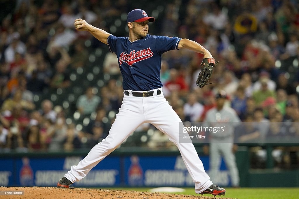 <a gi-track='captionPersonalityLinkClicked' href=/galleries/search?phrase=Ryan+Raburn&family=editorial&specificpeople=2541483 ng-click='$event.stopPropagation()'>Ryan Raburn</a> #9 of the Cleveland Indians, who normally plays outfield, pitches during the ninth inning against the Detroit Tigers Progressive Field on August 8, 2013 in Cleveland, Ohio.