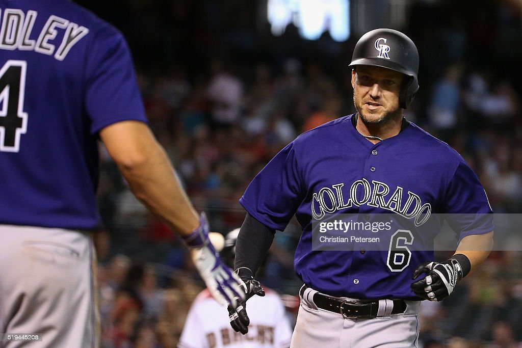 Ryan Raburn #6 of the Colorado Rockies high-fives Nick Hundley #4 after Raburn hit a solo home run against the Arizona Diamondbacks during the seventh inning of the MLB game at Chase Field on April 6, 2016 in Phoenix, Arizona.
