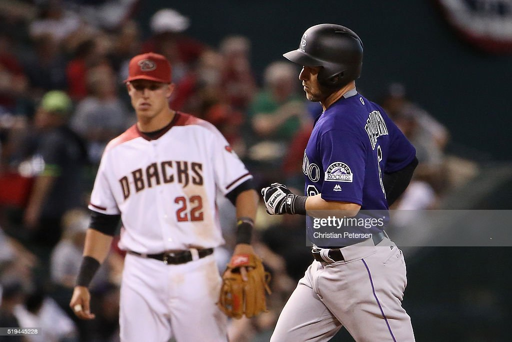 Ryan Raburn #6 of the Colorado Rockies rounds the bases past infielder Jake Lamb #22 of the Arizona Diamondbacks after Raburn hit a solo home run during the seventh inning of the MLB game at Chase Field on April 6, 2016 in Phoenix, Arizona.