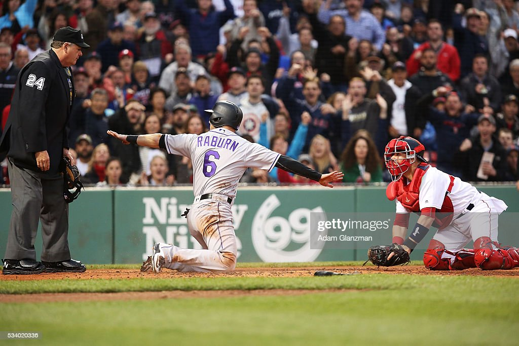 <a gi-track='captionPersonalityLinkClicked' href=/galleries/search?phrase=Ryan+Raburn&family=editorial&specificpeople=2541483 ng-click='$event.stopPropagation()'>Ryan Raburn</a> #6 of the Colorado Rockies signals that he is safe at home plate in the second inning during the game against the Boston Red Sox at Fenway Park on May 24, 2016 in Boston, Massachusetts. Raburn was initially called out, but the call was reversed following review.