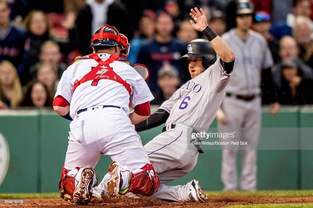 <a gi-track='captionPersonalityLinkClicked' href=/galleries/search?phrase=Ryan+Raburn&family=editorial&specificpeople=2541483 ng-click='$event.stopPropagation()'>Ryan Raburn</a> #6 of the Colorado Rockies slides as he avoids the tag of Christian Vazquez #7 of the Boston Red Sox to score during the second inning of a game on May 24, 2016 at Fenway Park in Boston, Massachusetts.