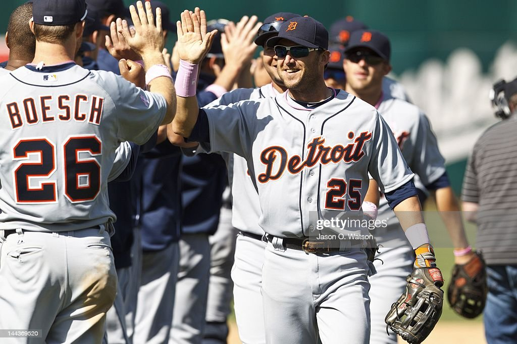 <a gi-track='captionPersonalityLinkClicked' href=/galleries/search?phrase=Ryan+Raburn&family=editorial&specificpeople=2541483 ng-click='$event.stopPropagation()'>Ryan Raburn</a> #25 of the Detroit Tigers celebrates with <a gi-track='captionPersonalityLinkClicked' href=/galleries/search?phrase=Brennan+Boesch&family=editorial&specificpeople=6754960 ng-click='$event.stopPropagation()'>Brennan Boesch</a> #26 after the game against the Oakland Athletics at O.co Coliseum on May 13, 2012 in Oakland, California. The Detroit Tigers defeated the Oakland Athletics 3-1.
