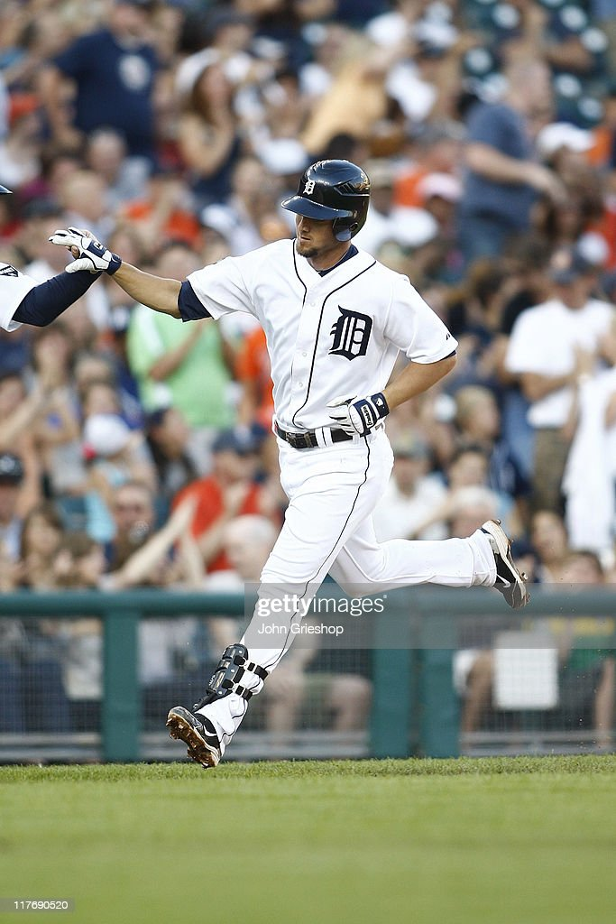 <a gi-track='captionPersonalityLinkClicked' href=/galleries/search?phrase=Ryan+Raburn&family=editorial&specificpeople=2541483 ng-click='$event.stopPropagation()'>Ryan Raburn</a> #25 of the Detroit Tigers rounds the bases after connecting for a homerun during the game against the New York Mets on June 29, 2011 at Comerica Park in Detroit, Michigan. The Mets defeated the Tigers 16-9.
