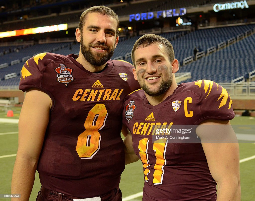 Ryan Radcliff #8 and Cody Wilson #11 of the Central Michigan University Chippewas pose for a photo the after the victory against the Western Kentucky University Hilltoppers in the Little Caesars Pizza Bowl at Ford Field on December 26, 2012 in Detroit, Michigan. The Chippewas defeated the Hilltoppers 24-21.