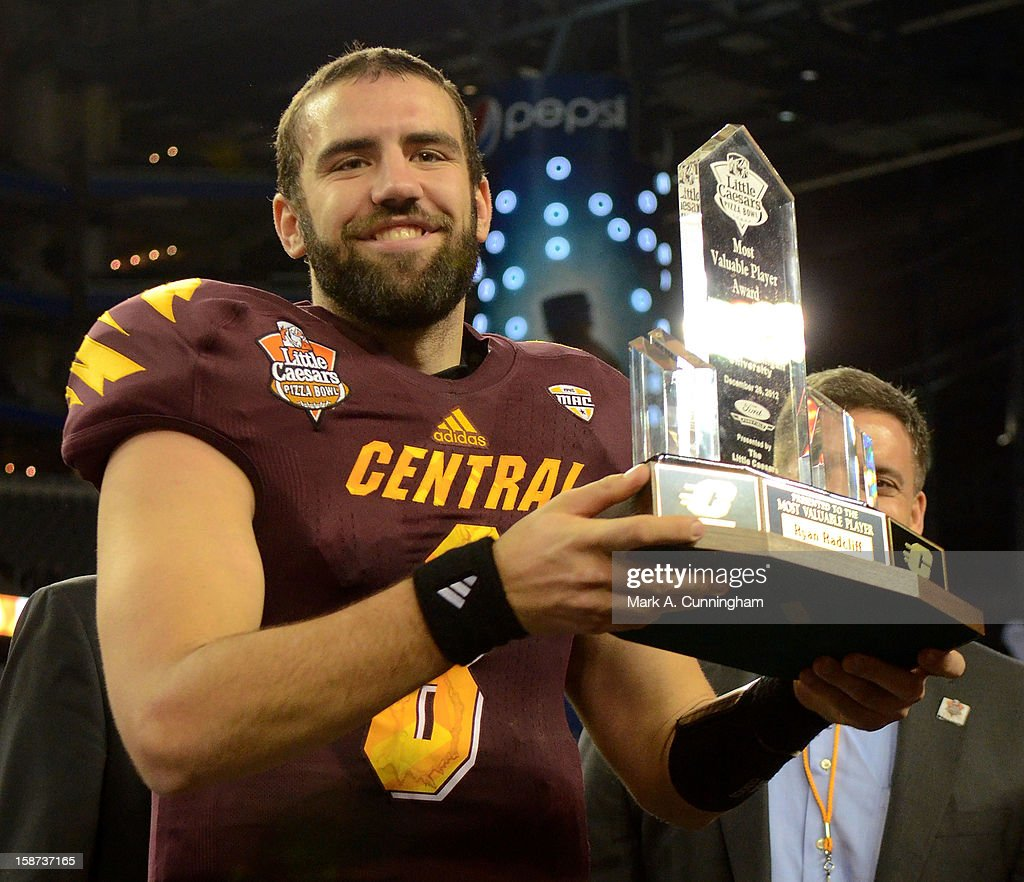 Ryan Radcliff #8 of the Central Michigan University Chippewas holds up the Little Caesars Pizza Bowl Most Valuable Player Trophy after the victory against the Western Kentucky University Hilltoppers at Ford Field on December 26, 2012 in Detroit, Michigan. The Chippewas defeated the Hilltoppers 24-21.