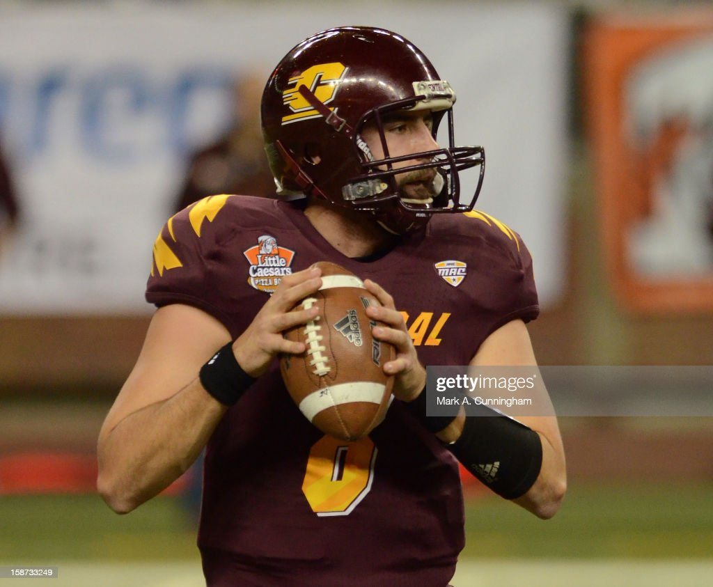 Ryan Radcliff #8 of the Central Michigan University Chippewas looks to throw a pass in the first quarter of the Little Caesars Pizza Bowl against the Western Kentucky University Hilltoppers at Ford Field on December 26, 2012 in Detroit, Michigan.