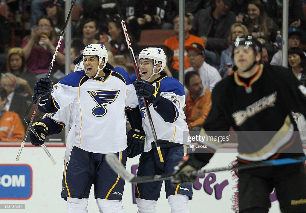 Ryan Reaves #75 and Adam Cracknell #79 of the St. Louis Blues celebrate Reaves' first period goal against the Anaheim Ducks at Honda Center on March 10, 2013 in Anaheim, California.
