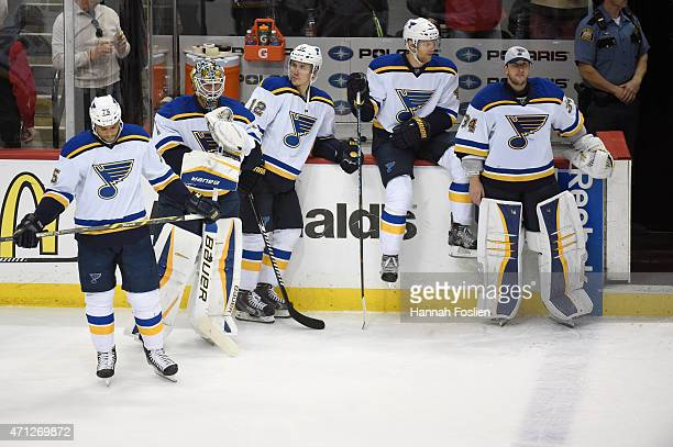 Ryan Reaves Brian Elliott Jori Lehtera Carl Gunnarsson and Jake Allen of the St Louis Blues look on after a loss to the Minnesota Wild of Game Six of...