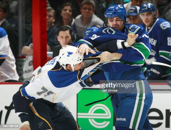 Ryan Reaves of the St Louis Blues and Tom Sestito of the Vancouver Canucks fight during their NHL game at Rogers Arena March 19 2013 in Vancouver...
